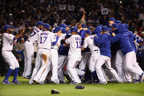 CHICAGO, IL - OCTOBER 13:  The Chicago Cubs celebrate defeating the St. Louis Cardinals 6-4 in game four of the National League Division Series at Wrigley Field on October 13, 2015 in Chicago, Illinois.  (Photo by Jonathan Daniel/Getty Images)