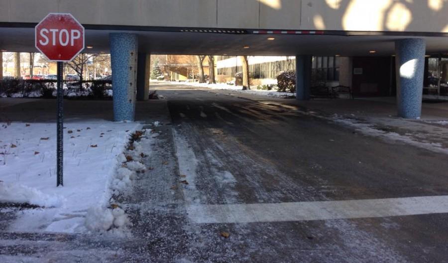 New+stop+sign+before+the+bridge+in+Regina+Dominican%27s+parking+lot