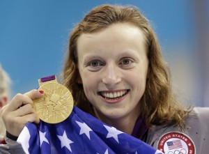 United States' Katie Ledecky holds up her gold medal after winning the women's 800-meter freestyle. Photo courtesy of AP Photo/Lee Jin-man.