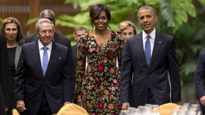 President Obama wif his wife and President Castro in Cuba. Photo Credit: Chris Carlson/AP.