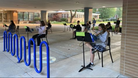 The Regina Dominican Orchestra practicing outside early in the morning. Wilmette, Illinois.