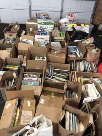 Photo courtesy of Abbey Farmer. Boxes and boxes of books were collected for Jamieson Grade School.