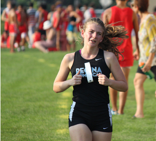 Ellie Spina running in a Cross Country meet
