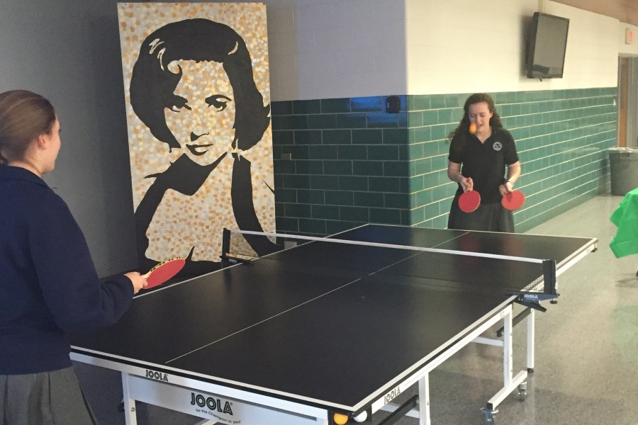 Clare Broderick '16 and Jessica Wollney '16 play ping pong.  Kathryn Cressy/The Crown.