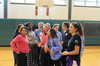 Sophomores strategize their dodge ball game plan. Photo Credit/Ana Lopez