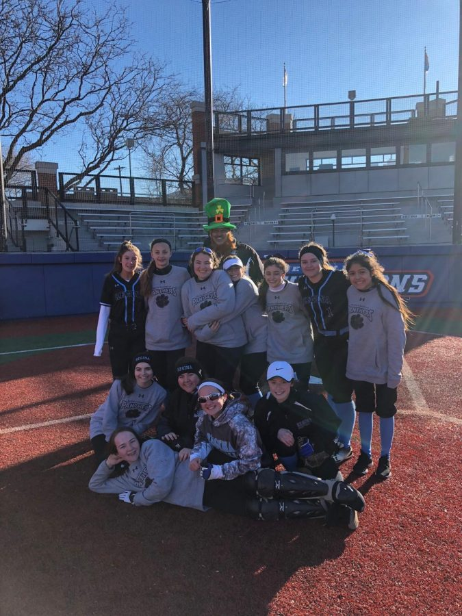 Varsity+Softball+celebrates+their+St.+Patrick%27s+day+victory+after+their+first+double+header+of+the+season