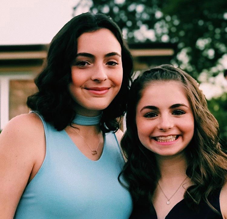 Juniors Molly Fay and Nicolette Anichini smile big for a picture before the dance